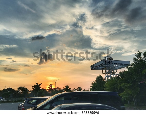 Sepang, Selangor. April 17, 2017. Sunset at parking lot of Mitsui Outlet Park KLIA Sepang, a Japanese factory outlet shopping mall near airport with wide range of branded goods at attractive price.