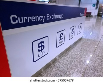 Sepang, Selangor - March 7, 2017: View of currency exchange center at Kuala Lumpur International Airport. Ringgit Malaysia have suffered devaluation against dollar due to the impact of oil and gas.
