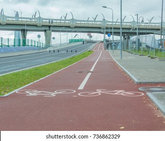 a separate bike path in the city goes under the bridge