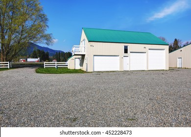 Perfect Separate Garage Building With Three Garage Doors And Gravel Driveway Around
