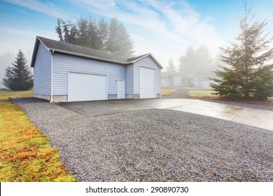 Separate Garage And Shop Room With Driveway.