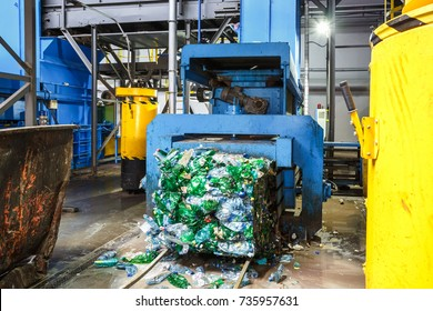 Separate garbage collection. Equipment for pressing debris sorting material to be processed in a modern waste recycling plant.