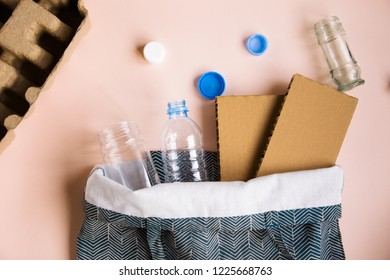 Separate garbage collection. Recyclable materials. Plastic, paper, glass. Bottles, caps, cardboard, egg packaging. Saving planet. Ecological problem. Reasonable consumption. Eco bag