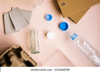 Separate garbage collection. Recyclable materials. Plastic, paper, glass. Bottles, caps, cardboard, egg packaging. Saving planet. Ecological problem. Reasonable consumption.