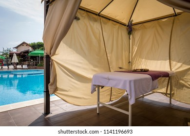 a separate massage area next to a mineral water pool. Body and soul care & spa tent Images Stock Photos u0026 Vectors | Shutterstock