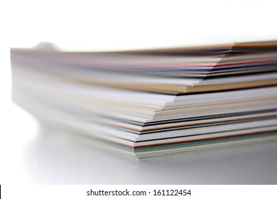 separating stacked sheets to organize a folder with white background