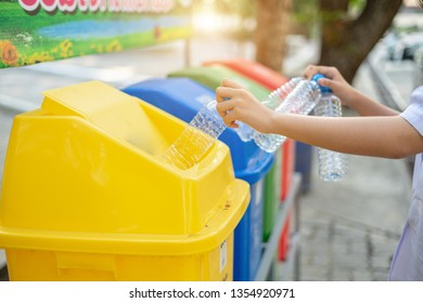 Separating waste plastic bottles into recycling bins is to protect the environment, causing no pollution, reduce global warming, helping to balance the ecology. It is  environmentally friendly action.