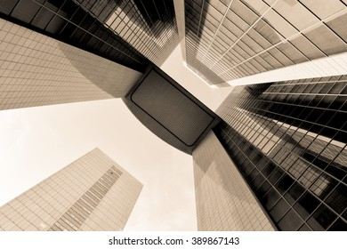 Sepia abstract buildings made of steel and glass. High urban impressive modern construction concept. Monochrome business center view over dramatic sky. Finance center sepia conceptual background.