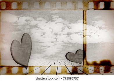 Sepia film strip frame with two hearts in surreal landscape. Valentine's day.