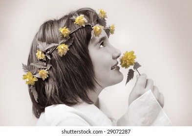 Sepia image of beautiful girl with flowers