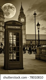 Sepia image of The Big Ben in London with a bright full moon and a phone booth in the foreground
