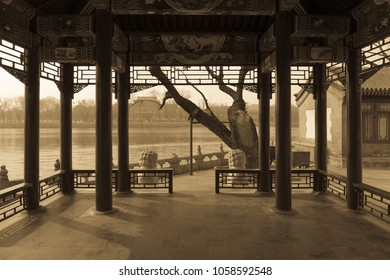 Sepia image of view from a lakeside pavilion at Beihai Park, Beijing, China.
