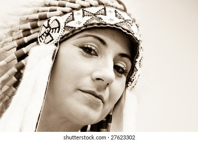 Sepia portrait of a beautiful Indian woman.