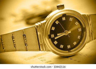 sepia tint watch time concept with calendar
