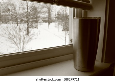 Sepia tone on a coffee cup with a snow background