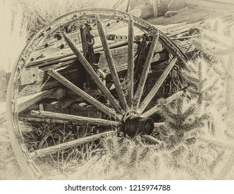 Sepia toned B&W of an antique wagon wheel in the Dessert.