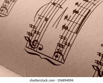 sepia toned fragment of sheets of musical notes