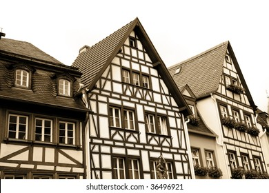 Sepia toned half-timbered houses in the old town of Mainz the capital of the German federal state of Rhineland-Palatinate.