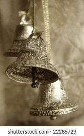 Sepia toned image of three silver bells