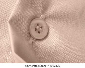 sepia toned shirt fragment with button closeup