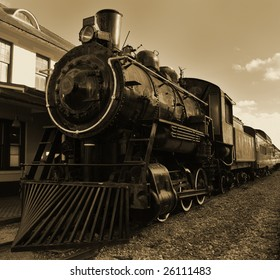 Sepia toned shot of old fashioned steam train