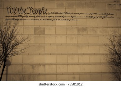 A sepia toned view of the preamble to the Constitution on the wall of THe Constitution Center in Philadelphia.