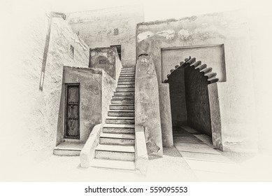 Sepia view of the arched entrance of Riffa Fort, Bahrain from the courtyard on a sunny day. A stone staircase leads through adobe walls with a door and lattices for ventilation to rooms above.