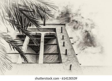 A sepia view looking upwards through the leaves of a palm tree towards a wind catcher, a traditional Arabian ventilation tower on a restored adobe building in the Arabian Gulf.