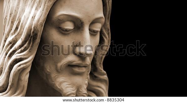 Sepia-toned Jesus statue, copy-space
