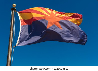 SEPT 13. 2018, Arizona - Arizona Flag waves in blue sky in Arizona