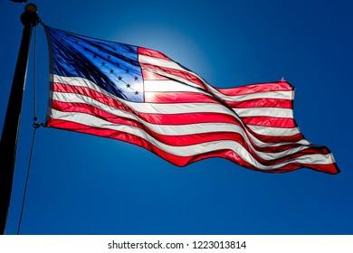 SEPT 13. 2018, Arizona - US Flag waves in blue sky in Arizona