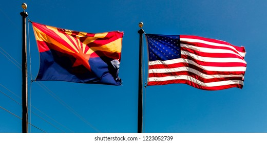 SEPT 13, 2018  Arizona, USA - Arizona and US Flag fly in a blue sky