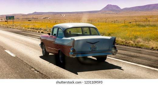 SEPT 13, 2018 - Texas, USA - Vintage 1957 historic Chevrolet drives through remote Texas Landscape.