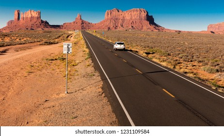 SEPT 14, 2018 - Monument Valley, Utah, USA - SUV drives toward Monument Valley on Utah/Arizona border, American southwest