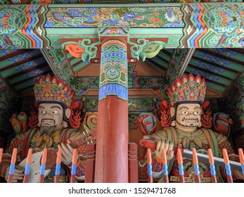 SEPT. 15, 2019-BUSAN, SOUTH KOREA : Beomeosa Temple. Wooden Korean Guardian Sculptures before entrance in Beomeosa Temple