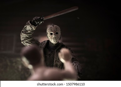 SEPT 17 2019: Horror movie slasher Jason Voorhees hacking a victim at Camp Crystal Lake - Neca Jason action figure