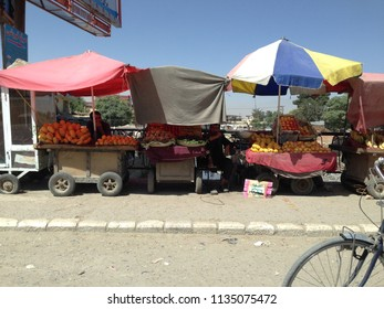 Sept 20, 2017 Kabul Afghanistan. Local fruit market on the street, downtown Kabul. They sell fresh fruit off their own field.