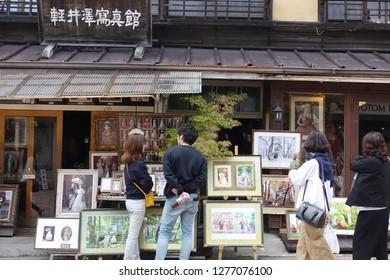 Sept 2018 - Karuizawa, JAPAN: Tourist admiring the paints and arts of Karuizawa Photo Studio.