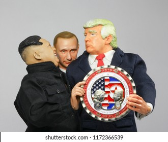 SEPT 3 2018: Caricatures of president Donald Trump, Vladimir Putin and Kim Jong-Un holding a commemorative coin for the US and Supreme Leader North Korean peace summit held in Singapore in 2018