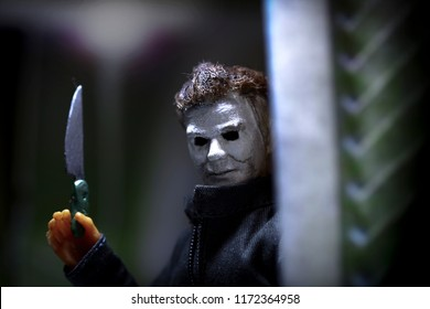 SEPT 3 2018: Recreation of a scene from the 1978 movie Halloween; Michael Myers (the shape) holding a knife while breaking into a closet where Laurie Strode is hiding
