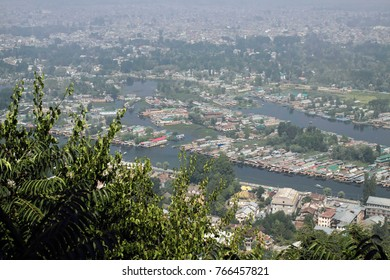 Sept2017,Srinagar, Jammu and Kashmir, India, the lake of Srinagar looks crowded in the misty early morning sunlight, looking down from the surrounding mountains