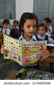 September 08, 2018 Allahabad Uttar Pradesh/India: A Girl child reading book at a Government school on the occasion of World Literacy Day in Allahabad on 08-09-2018.