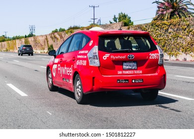 September 1, 2019 Redwood City / CA / USA - Flywheel Taxicab driving on the highway in San Francisco bay area;