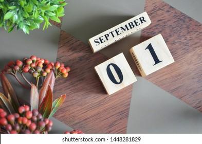 September 1. Date of September month. Diamond wood table for background.