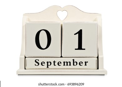 September 1 on a decorative calendar of large beige cubes isolated on white background