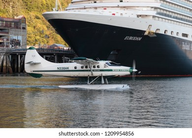 September 10 2018 Juneau Alaska. Seaplane in front of a big cruise ship in Juneau harbor Alaska.