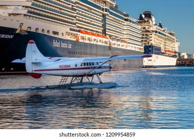September 10 2018 Juneau Alaska. Seaplane in front of a big cruise ship in Juneau harbor Alaska.