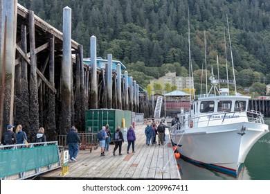 September 10 2018 Juneau Alaska. Passengers boarding  a boat in  Juneau harbor Alaska.