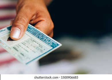 September 10, 2019, Brazil. Man holds National Driver's License (CNH). Official document of Brazil, which attests the ability of a citizen to drive land vehicles