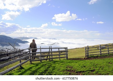 SEPTEMBER 10,2010 TRABZON.The Iskopil Plateau of  Macka province of Trabzon city,Turkey.Model standing toward to the sunset between the fences.